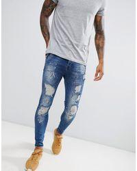 SIKSILK Jean taille basse skinny avec éclaboussures - Bleu