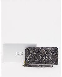 BCBGeneration Tara Snakeskin Wallet - Black