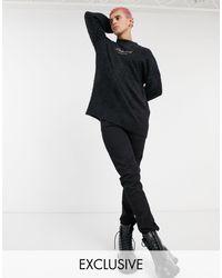 Reclaimed (vintage) Jersey negro mullido con logo