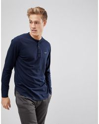 Hollister - Logo Henley Long Sleeve Top In Navy - Lyst