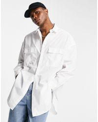ASOS Longline Shirt With Double Pockets And Curved Hem - White