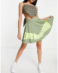Love Moschino - Расклешенная Зеленая Юбка Мини С Логотипом -зеленый Цвет - Lyst