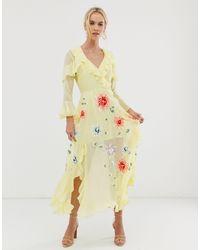 ASOS Vestido largo con diseño cruzado y bordados - Amarillo