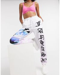 Jaded London Oversized joggers With Fantasy Dolphin Graphic Co-ord-white