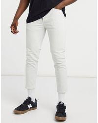 River Island – Schmal zulaufende Jeans - Weiß