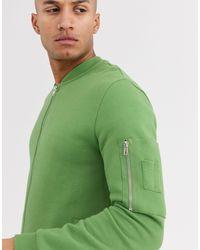 ASOS – Lange Bomberjacke aus Jersey mit MA1 Tasche - Grün