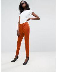 ASOS Asos Washed Skinny Trousers With Stirrup Detail - Orange