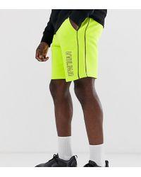 ASOS Tall- Jersey Short In Neon Wassing Met Textprint - Geel