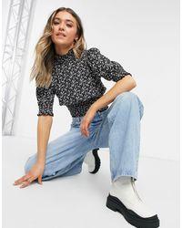 ONLY – Hochgeschlossene Bluse mit geraffter Taille und Bündchen - Blau