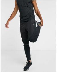Reebok Joggers da allenamento neri con inserti - Nero