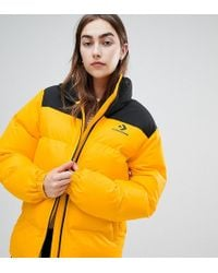 0acb4c080fd5 Converse - Oversized Exclusive Yellow Padded Jacket - Lyst