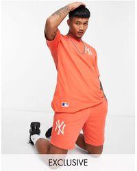 KTZ Shorts naranjas