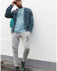 """ASOS – Schweres, langärmliges Oversize-Shirt mit Acid-Waschung und """"Dark Future""""-Logo - Grün"""