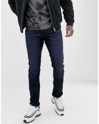 Jack & Jones Intelligence – Schmale Jeans mit dunkler Waschung - Blau