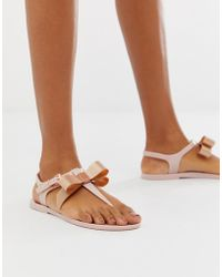 7e8e67407548 Ted Baker Rose Gold Floral Bow Detail Flip Flop in Metallic - Lyst