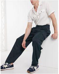 ASOS Pantaloni slim a vita alta con tasche cargo e cuciture a contrasto - Blu