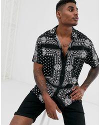 Bershka Camisa con estampado - Negro