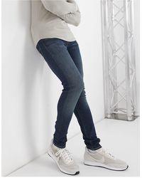 Levi's – Enge, schmal zulaufende Jeans - Blau