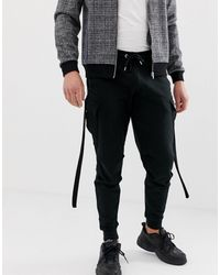 ASOS Tapered sweatpants With Cargo Pockets And Strapping - Black