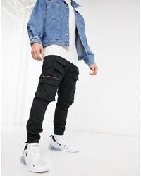 Good For Nothing Pantalon cargo avec poches fonctionnelles - Noir