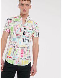 Love Moschino Chemise manches courtes avec logos sur l'ensemble - Blanc