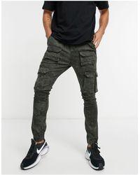 Good For Nothing Pantalon cargo à poches - délavé - Vert