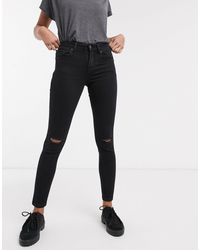 Bershka – Enge, schwarze Push-up-Jeans mit Knierissen