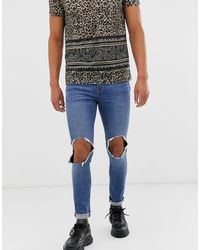 ASOS Super Skinny Jeans In Mid Wash Blue With Open Knee Rip