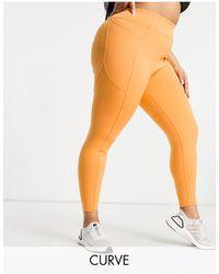 ASOS 4505 Curve - legging emblématique avec coutures effet sculptant et poche - Orange