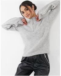 Vero Moda - Jersey gris con cuello alto y media cremallera - Lyst
