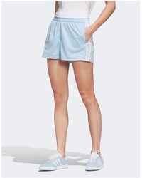 adidas Originals – adicolor – e Shorts mit drei Streifen - Blau