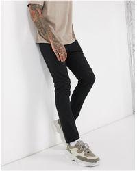 SELECTED – Eng geschnittene Jeans aus Bio-Baumwolle - Schwarz