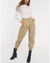 Bershka Jeans extra larghi cammello con bordo aderente - Marrone