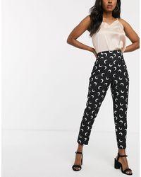 Never Fully Dressed Pantaloni a sigaretta con lune stampate - Nero