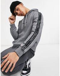 Champion Felpa con cappuccio con fettuccia con logo, colore grigio