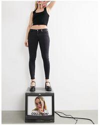 Collusion X001 - jeans skinny a vita bassa slavato - Nero