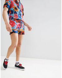 Jaded London – Shorts mit Fisch- und Blumenmuster - Blau