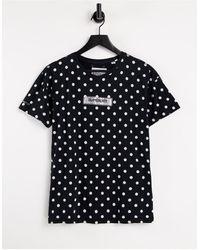 Superdry Studio 395 - T-shirt nera a pois con logo - Nero