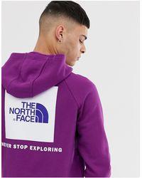 The North Face Sudadera con capucha violeta con manga raglán y cuadro rojo - Morado