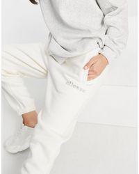 Ellesse - Серовато-белые Джоггеры С Выложенным Стразами Логотипом – Эксклюзивно Для Asos-белый - Lyst
