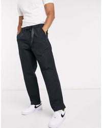 Levi's Pantalones estilo excursionista con cinturón y trabilla en negro Stay Loose Climber