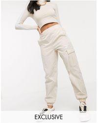 PUMA Pantaloni multitasche a vita alta crema - Neutro
