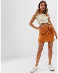 38b63df30 Minifalda naranja con lazo lateral - Amarillo