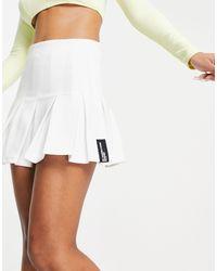 Bershka Minigonna da tennis a pieghe bianca - Bianco