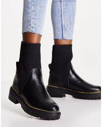River Island Botas negras estilo calcetín con suela gruesa tramada con tacón - Negro