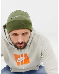 Nike Berretto mimetico con logo verde 876501-396