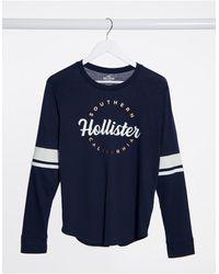 Hollister Темно-синий Лонгслив С Логотипом На Груди