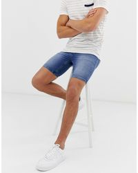 ASOS Short seconde peau en denim power stretch - Délavage moyen - Bleu
