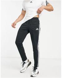 adidas Originals Adidas - Joggers con 3 strisce neri - Nero