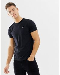 Hollister - Crew Neck Core Icon Logo T-shirt Slim Fit In Black - Lyst